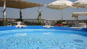 Seasonal outdoor pool, a rooftop pool, pool umbrellas, pool loungers