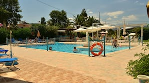 Seasonal outdoor pool, open 8:30 AM to 9 PM, pool umbrellas