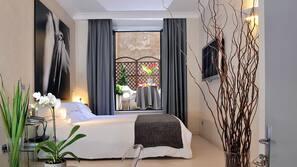 Premium bedding, memory foam beds, free minibar, in-room safe