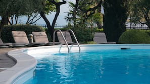 2 outdoor pools, open 8:00 AM to 7:00 PM, pool loungers