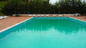 Seasonal outdoor pool, a rooftop pool, sun loungers