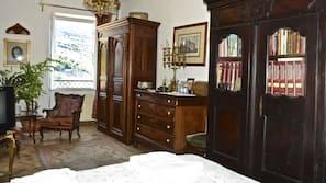 Edredones de plumas, minibar, caja fuerte y decoración individual