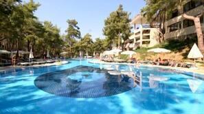 Indoor pool, pool umbrellas, pool loungers