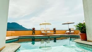 Seasonal outdoor pool, open 9:00 AM to 5:00 PM, pool umbrellas