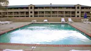 Seasonal outdoor pool, open 10:30 AM to 10 PM, pool umbrellas