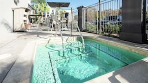 Outdoor pool, open 9:00 AM to 9:00 PM, pool umbrellas