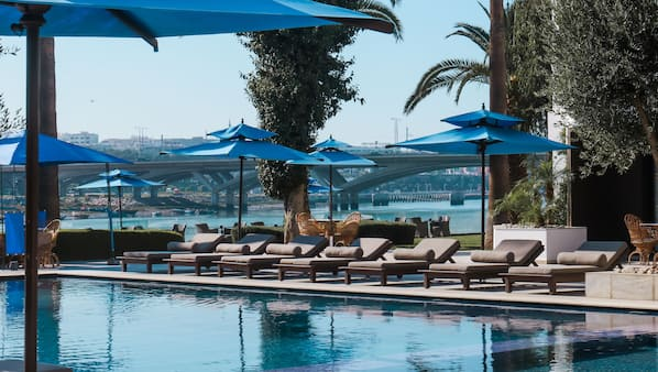Outdoor pool, open 9 AM to 6:30 PM, pool umbrellas, sun loungers