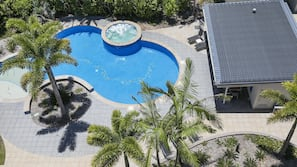 Outdoor pool, open 7:30 AM to 9:00 PM, pool umbrellas