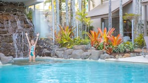 3 outdoor pools, open 7 AM to 10 PM, pool loungers