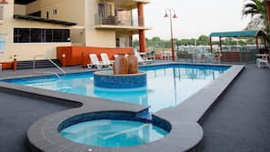 3 outdoor pools, open 8:00 AM to 8:00 PM, pool loungers