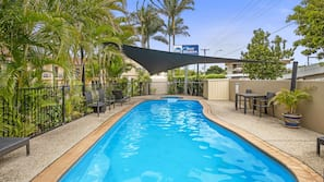 Outdoor pool, open 7:00 AM to 8 PM, pool umbrellas, pool loungers