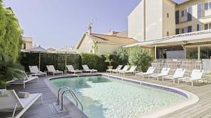 Seasonal outdoor pool, open 8 AM to 9:00 PM, pool umbrellas