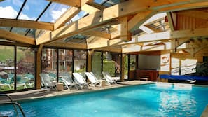 Indoor pool, open 9:00 AM to 9:00 PM, pool umbrellas, pool loungers