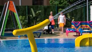 Outdoor pool, open 11:00 AM to 3:00 PM, pool umbrellas, pool loungers