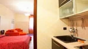 Full-sized fridge, microwave, espresso maker, cookware/dishes/utensils