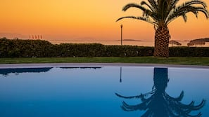 2 outdoor pools, open 10:00 AM to 8:00 PM, pool umbrellas, pool loungers