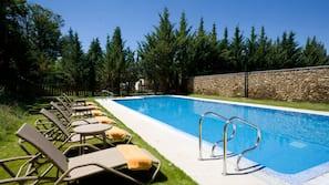 Seasonal outdoor pool, open noon to 8:00 PM, pool umbrellas