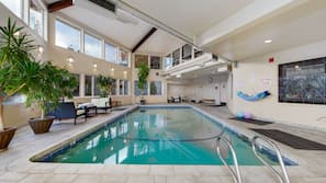 Indoor pool, open 6 AM to midnight, pool umbrellas, pool loungers