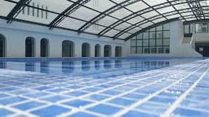 Indoor pool, open 8 AM to 8 PM, pool umbrellas, pool loungers