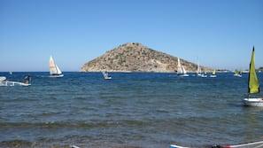 On the beach, free beach shuttle, free beach cabanas, beach umbrellas