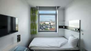 Hypo-allergenic bedding, down duvets, desk, blackout curtains