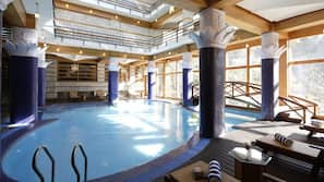 Indoor pool, open 9:00 AM to 6:00 PM, pool loungers