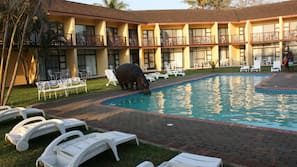 Outdoor pool, open 6:00 AM to 10:00 PM, sun loungers