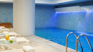 Indoor pool, open 6 AM to 11 PM, pool loungers