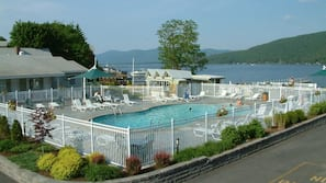 Seasonal outdoor pool, open 9:00 AM to 9:00 AM, pool loungers