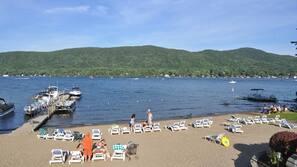 On the beach, sun loungers, kayaking, rowing