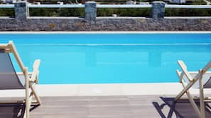 Seasonal outdoor pool, open 8:00 AM to 7:30 PM, sun loungers