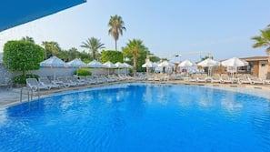 Seasonal outdoor pool, open 9:30 AM to 9:00 PM, pool umbrellas