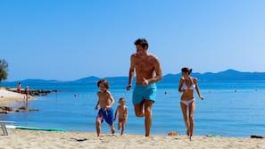 Private beach, sun-loungers, beach umbrellas, waterskiing