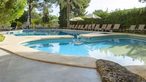 Outdoor pool, open 10:00 AM to 8:00 PM, pool umbrellas, pool loungers