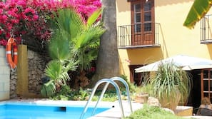Outdoor pool, open 9 AM to 10:30 PM, pool umbrellas