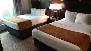 Hypo-allergenic bedding, desk, laptop workspace, blackout drapes