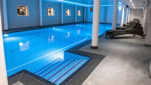 Indoor pool, open 7:00 AM to 8:00 PM, pool loungers