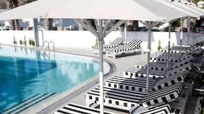 Seasonal outdoor pool, open 8 AM to 8 PM, free pool cabanas