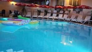 Seasonal outdoor pool, open 7 AM to midnight, pool umbrellas