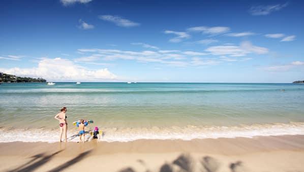 On the beach, beach cabanas, sun loungers, beach towels