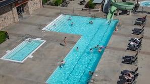 Seasonal outdoor pool, open 9:00 AM to 10 PM, pool umbrellas