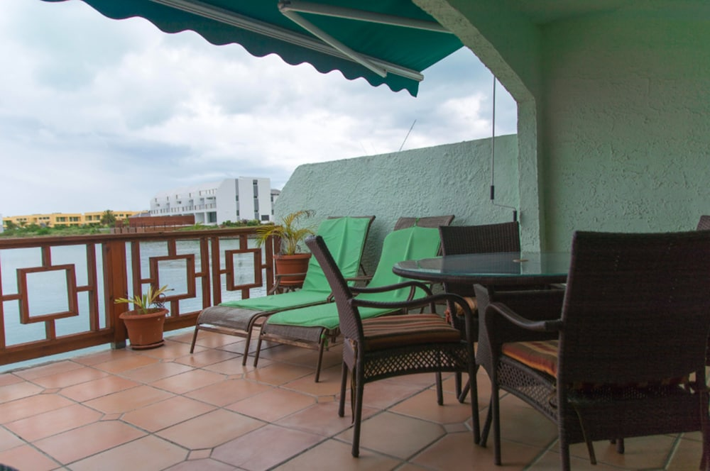 Balcony, HBK Villa Rentals at Jolly Harbour