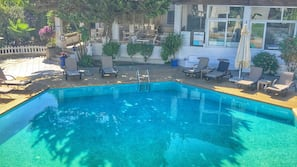 Outdoor pool, open 8:00 AM to 7:30 PM, pool umbrellas, pool loungers