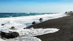 Beach nearby, black sand, 5 beach bars