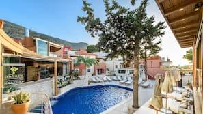 Seasonal outdoor pool, open 9 AM to 7 PM, pool umbrellas, pool loungers
