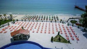 On the beach, sun loungers, beach umbrellas, beach yoga