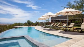 2 outdoor pools, open 7:00 AM to 8:00 PM, pool umbrellas, pool loungers