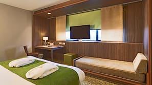 Minibar, coffre-forts dans les chambres, bureau, rideaux occultants