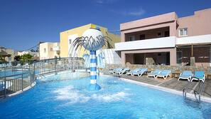 5 outdoor pools, open 8 AM to 8 PM, pool umbrellas, pool loungers
