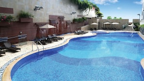 Seasonal outdoor pool, open 9:00 AM to 8:00 PM, pool umbrellas